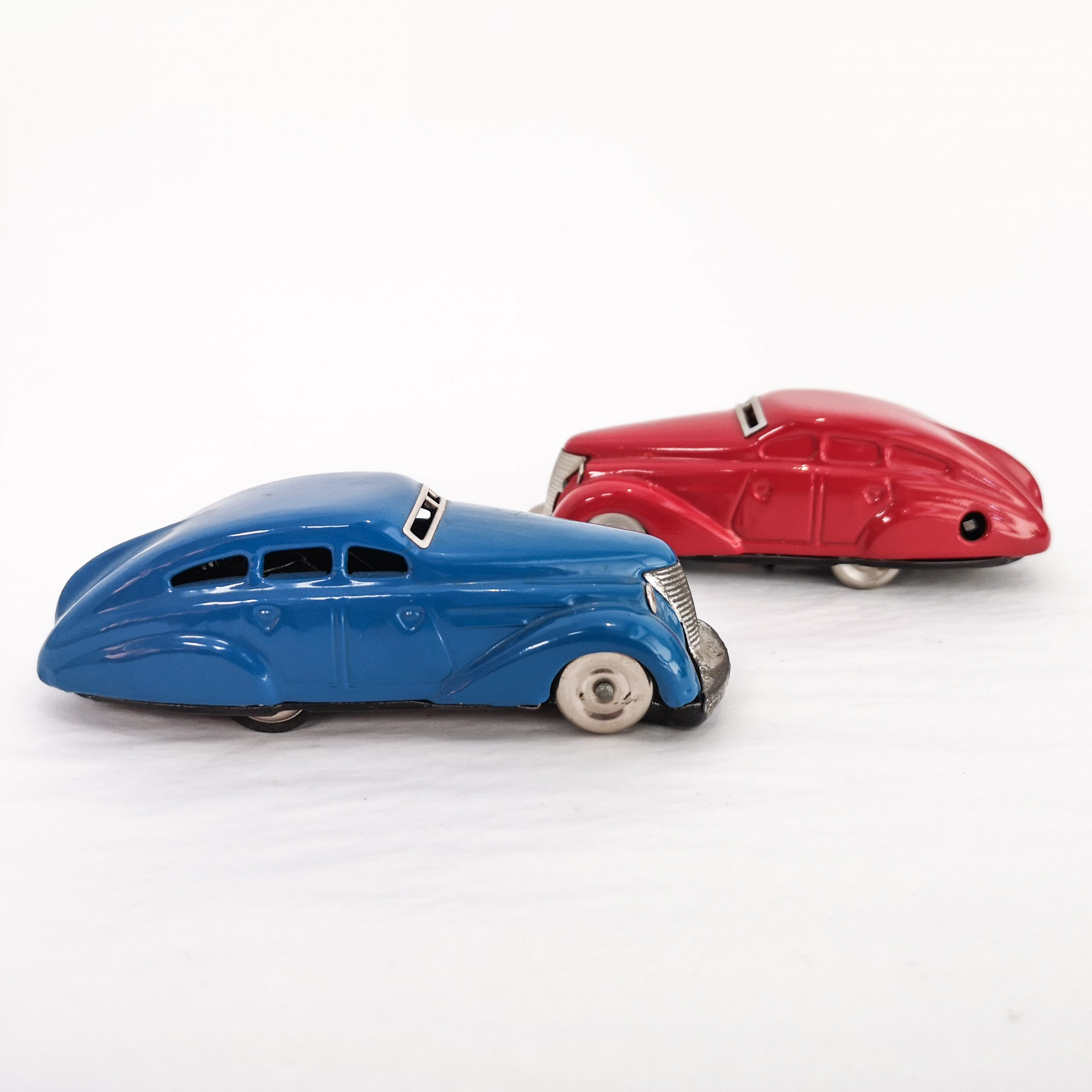 Blue and red Schuco Limousine tinplate clockwork cars with patented turn-back mechanism. 2