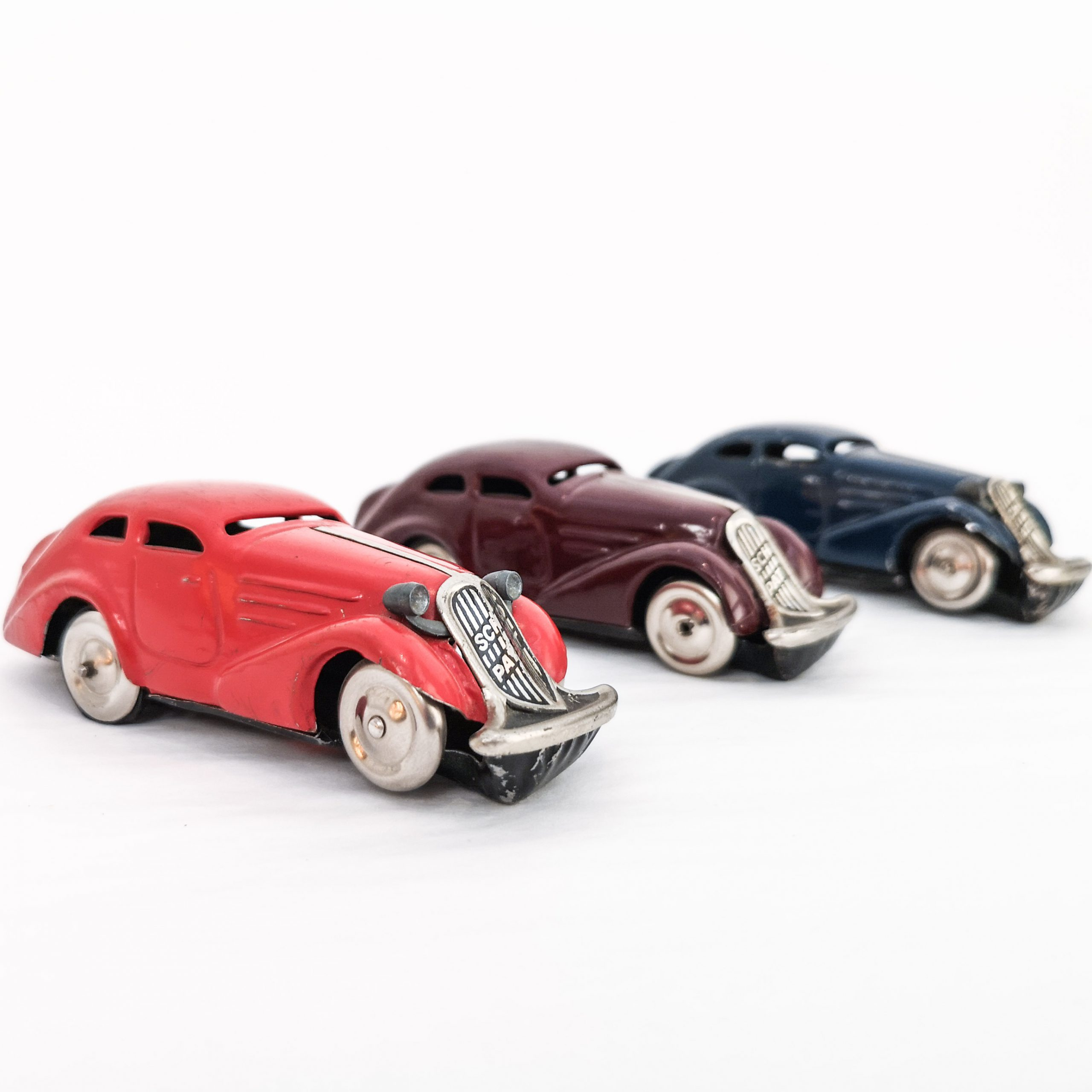 hree Schuco Patent Auto tinplate clockwork cars with turn-back feature. 1.5