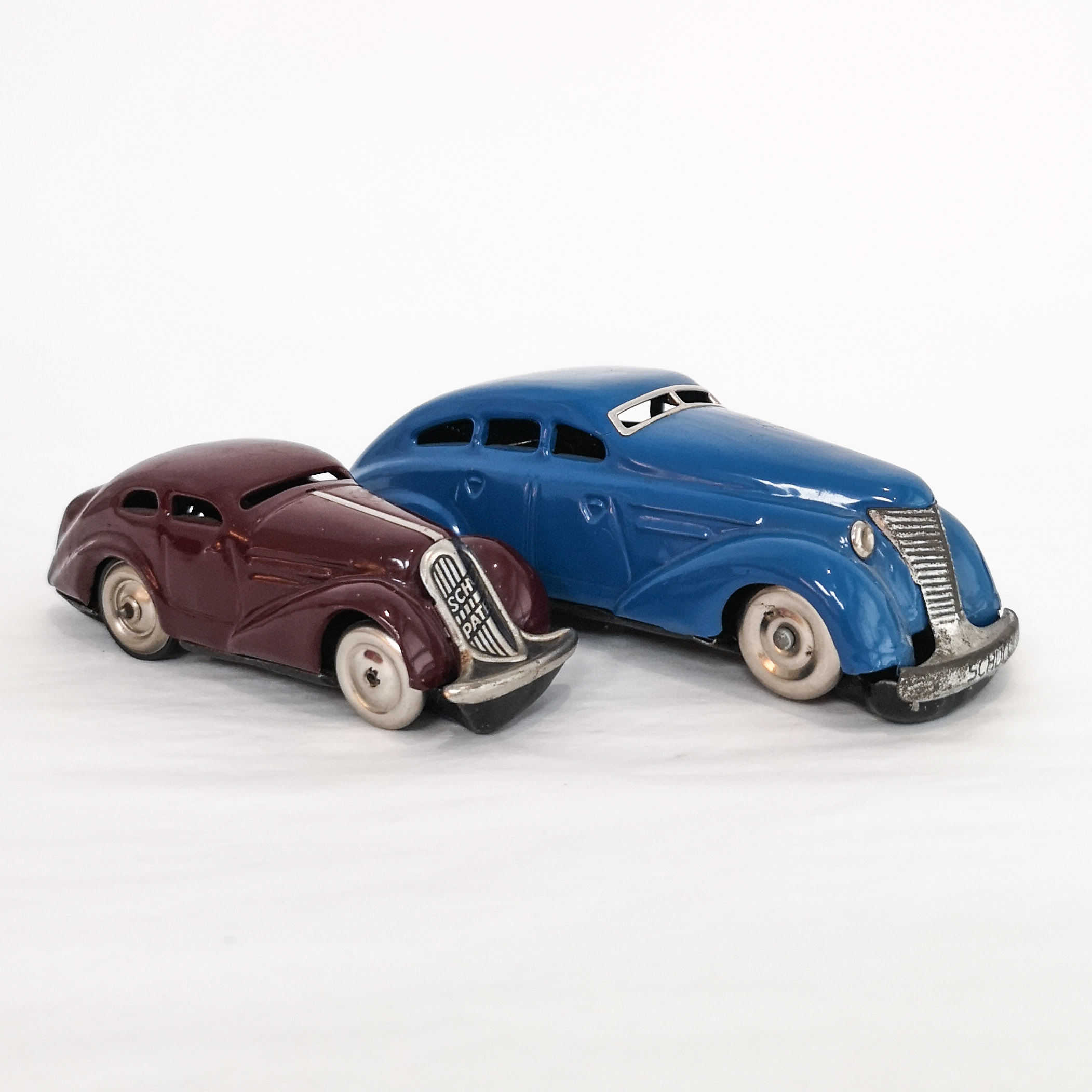 Plum Patent Auto with blue Limousine, both with Schuco's patented turn-back mechanism.