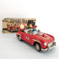 Mystery Action Bump & Go Battery-Op  Fire Chief Car. Manufactured by Sanshin. Made in Japan c. 1950.