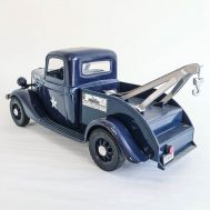 Jim Beam police truck bourbon decanter. The bed of this porcelain and plastic pickup can be removed to reveal the lid of the decanter. Made in the USA, this bottle models the 1935 Ford Model A tow truck.