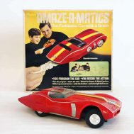 Hasbro Amaze-A-Matics  battery-powered toy car, c, 1969. Car's course could be pre-programmed with cards inserted into the bottom of the vehicle. Notches cut into the sides of the cards determine if the car goes forward, backwards, straight, left or right.