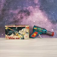 """Friction Baby Space Gun, tin litho, manufactured by Daiya in Japan, ca. 1950. 6"""" long. ID#2942"""