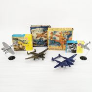C. 1950 Airplane models depicting aircraft which would have been flown by the USAAF and the RAF during WWII, such as the Lockheed P-38 Lightning and the Spitfire IX, or the Junkers Ju 88, which was flown by the Luftwaffe