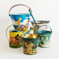 Assorted Tin-Litho Beach Pails. Made in the USA, c.1920-1940.