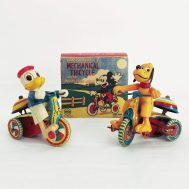 """Donald and Pluto Windup Tricycle. Celluloid and lithographed tin. Prodcuded by Linemar Toys, copyright to Disney. Made in Japan, ca. 1950. 4""""tall.  ID#2020.5.1-2020.6.1"""