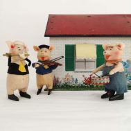 Schuco Walt Disney Windup Piggies in front of tin-litho dollhouse.  Made in Germany, c. 1934.