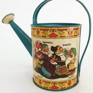 """Snow White & the 7 Dwarves tin-litho watering can. Made in the USA c. 1938. 7"""" tall."""