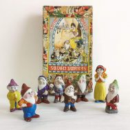 """Snow White and the Seven Dwarves. Bisque porcelain. Made in Japan, imported by George Borgfeldt Co. ca. 1938. figures range in height from 2.5-3""""."""