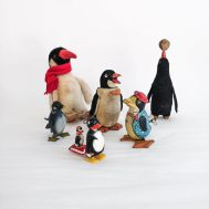 Pictured here is a ragtag group of mid-century penguin toys, from wind-up to ramp-walker, in lithographed tin, celluloid, mohair and plush.