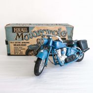 """Fix-All Motorcycle. Manufactured by Marx. Made in USA, c. 1950. Plastic, 10"""" long."""