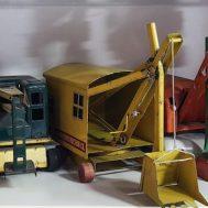 Shelf of vintage pressed steel construction toys.