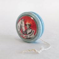 """""""Roundup King"""" Spinning Contest Roy Rogers Yo-Yo. Manufactured by Western Plastics Inc. Made in USA, c. 1940. 2"""" diameter. ID#2018.8.1a-i"""