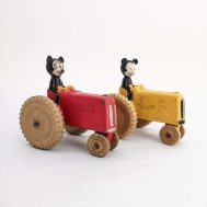 """Mickey Mouse Tractors. Rubber. Manufactured by Sun Rubber Company. Made in USA, c. 1940. 4.7"""" tall. ID#2017.9.13/2019.5.1"""
