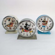 """Snow White, Mickey Mouse, & Pinocchio Clocks. Manufactured by Bayard.  Made in France, c. 1950, 1930, & 1960, respectively. 5"""" tall. ID#1833/1804/4003"""