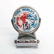 """1964-65 NYWF Desk Calendar.  Depicts the Unisphere in Flushing Meadows Park.  Manufactured by United States Steel.  Made in Japan, c. 1961. 3"""" tall. ID#2918"""