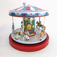 """Windup Carousel.  Manufactured by J. Chein. Made in the USA, c. 1950. 9.5"""" tall."""