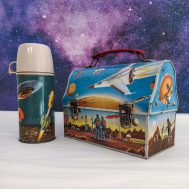 """Outerspace Lunchbox and Thermos. Manufactured by Thermos. Made in USA, c. 1950. Lunchbox 6.5"""" tall. Thermos 8"""" tall. ID#2721/2732"""
