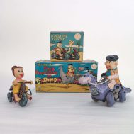 """Fred Flintstone on Dino and Wilma Flintstone on Tricycle   . Plastic and tin-litho. Manufactured by Marx. Made in Japan, 1962. 4.5"""" tall. ID#1875"""