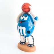 """Blue M&M Playing Basketball. Plastic candy dispenser. From the late '90s sports series of M&Ms candy dispensers. 13.5"""" tall. ID#2017.5.4"""