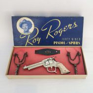 """Roy Rogers Forty Niner Pistol and Spurs. Manufactured by M.A. Henry Ltd. Made in Canada, c. 1950. Box 15"""" wide.  ID#11"""