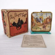 """Roy Rogers Alarm Clock. Manufactured by the E. Ingraham Company.  Made in USA, c. 1950. 4"""" tall. ID#2020.10.1"""