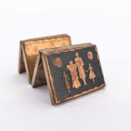 """Fold-Out Picture Frame. Contains sepia-toned photographs of a young girl and a baby boy. Brass, 2.5"""" tall. ID#3924"""