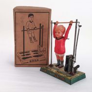"""Boy on Trapeze Windup Toy.  Celluloid & tin-litho. Manufactured by Kuramochi. Made in Japan, c. 1950. 8"""" tall. ID#2276"""
