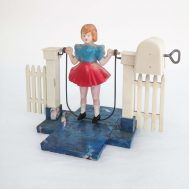 """Girl Skipping Rope Windup Toy. Made c. 1950. Girl is made of celluloid, jumprope of metal, and base of hard plastic. 6"""" tall. ID#3139."""