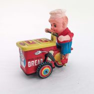 """Bread Vendor. Manufactured by Dott GR. Made in Japan, c. 1950. Celluloid & tin-litho. 4.5"""" tall. ID#3975"""