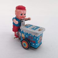 """Ice Cream Vendor. Manufactured by Dott GR. Made in Japan, c. 1950. Celluloid & tin-litho. 4.5"""" tall. ID#3974"""