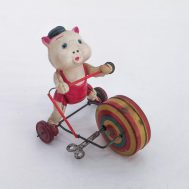 """Pig Riding Scooter Windup Toy. Trademarked """"SYY"""". Made in Japan, c. 1960. Celluloid & tin-litho, 4.5"""" tall. ID#3698"""