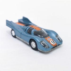 "Vintage Schuco Modell Gulf-Porsche 917 Rennsport. 1:66 scale, model 306 843. Metallic blue w/ orange racing stripe, ""Gulf"" decal and number 9 decal on hood"